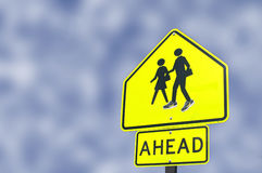 School Ahead Sign Boy With Shoes. School ahead sign at local high school where, no doubt, some kids have added shoes to the boy figure on the sign Stock Images