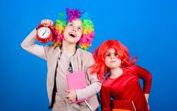 School alarm. Girl worry about time. Discipline and time concept. Circus school education. Time to have fun. Kids royalty free stock photo