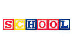 School - Alphabet Baby Blocks on white. School spelled out using baby blocks / colorful alphabet wood blocks stock images