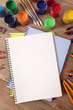 School art supplies with blank writing book on desk, copy space, vertical royalty free stock image