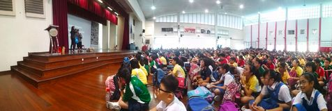 School assembly hall. School children sitting and listening to a talk at the assembly hall in Canberra Primary School, Singapore royalty free stock photo