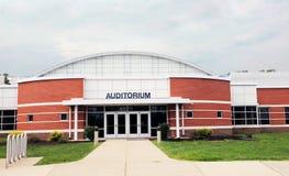 School Auditorium. Modern school auditorium with brick stones and glass entrance Stock Photo