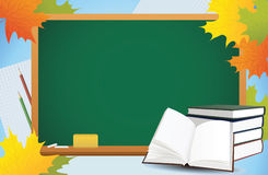 School autumn background with blackboard. Books and yellow leaves Stock Image