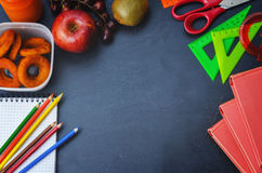 School background with books, school lunch, pencils and a notebo Royalty Free Stock Images