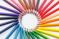 School background, creativity art. Learning to draw a concept,. Multicolored vibrant colored pencils on white background closeup Royalty Free Stock Images