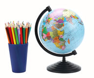 School background. Globe with colored pencils isolated on white background Stock Photo