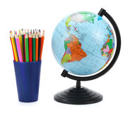 School background. Globe with colored pencils isolated on white background Stock Photos