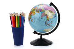 School background. Globe with colored pencils isolated on white background royalty free stock images