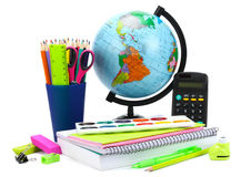 School background. Globe with colored pencils, pen, pains, paper for  school education isolated on white Stock Image