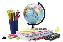 School background. Globe with colored pencils, pen, pains, paper for  school education  on white Royalty Free Stock Images