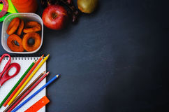 School background with school lunch, pencils and a notebook. Royalty Free Stock Photos