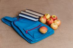 School backpack, apples and books, top view royalty free stock photos