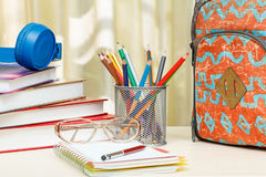 School backpack with school supplies. Books, metal stand for pen Royalty Free Stock Images