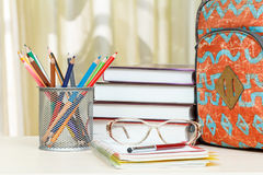 School backpack with school supplies. Books, metal stand for pen Stock Photography