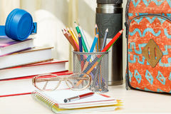 School backpack with school supplies. Books, metal stand for pen Stock Images