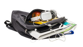 School backpack with school supplies and a tablet with headphone Royalty Free Stock Photos