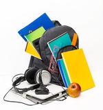School backpack with supplies and a tablet with headphones. Stock Photography