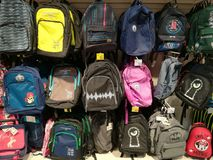 School backpacks for kids. Hanging in the supermarket Royalty Free Stock Photos