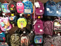 School backpacks for kids. Hanging in the supermarket Stock Photography