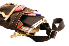 School bag. Collection of college gear in the bag on the white background stock photo