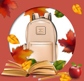 School bag and autumn leaves round frame. Back to school concept background Stock Images