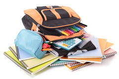 School bag, pencil case, books, pens, supplies, isolated on white background Royalty Free Stock Images