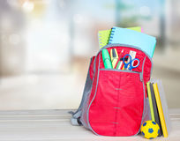 School bag on table indoors background. School supplies. Royalty Free Stock Photography