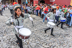 School band, Independence Day, Antigua, Guatemala. Antigua, Guatemala - September 15, 2015: School band marches in streets during Guatemalan Independence Day Royalty Free Stock Image