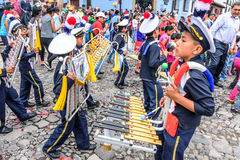 School band, Independence Day, Antigua, Guatemala. Antigua, Guatemala - September 14, 2015: School band marches in streets during Guatemalan Independence Day Stock Photo