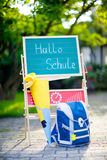 School beginning concept. Satchel and schoolbag, backpack, desk and traditional German school cone with gifts called. Schultuete in Germany. First day of royalty free stock photos
