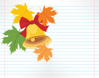 School bell and maple leaves on the notebook page Stock Photography