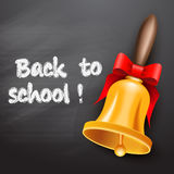 School bell with red ribbon Stock Images