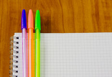 School belonging, notebook and three pens Stock Photos