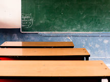 School benches facing blackboard Royalty Free Stock Photos