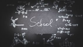 School black paper education exact science formula. Word school written on black paper. education and exact sciences concept. blurred background with formula royalty free stock photo