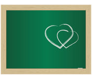 School Blackboard with the hearts. eps10. School Blackboard with the hearts drawn by a chalk. Vector Royalty Free Stock Images