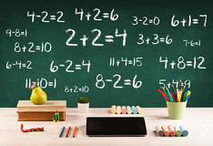 School blackboard with pile of books Stock Photo