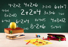 School blackboard with pile of books Stock Image