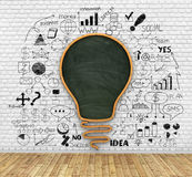 School blackboard in shape of idea lightbulb Royalty Free Stock Photo