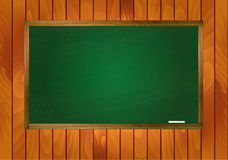 School blackboard on wooden background Stock Image
