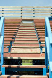 School Bleachers. A low angle view of a set of stairs climbing up some school bleachers Stock Photo