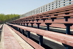 School Bleachers. Multiple levels of wooden bleachers used for watching sporting events Royalty Free Stock Photography