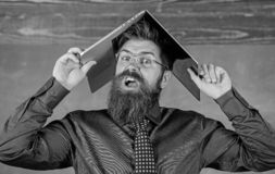School blows his mind. Hipster teacher aggressive with laptop as roof goes mad about teaching. Can not get used to. Teachers lifestyle. Teacher bearded man with stock photography