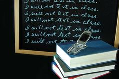 cell phone on school books Stock Photos