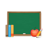 School board and books, pencil and apple Stock Photo