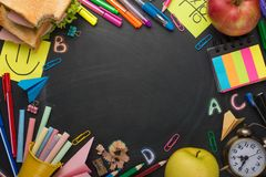 School board with handles, chalk, alarm clock, and school breakfast. With space for writing or advertising.  royalty free stock images
