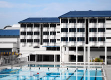 School boarding house with swimming pool Royalty Free Stock Photography