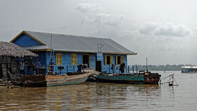 School with boat, Tonle Sap, Cambodia Stock Image