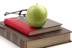 School Books. Hardcover school books and apple still life Stock Image