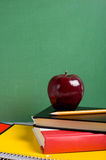 School Books And An Apple Stock Images